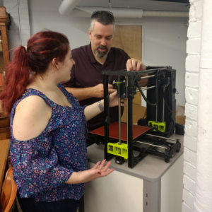 Liz Koziell and Dan Ward set up 3D Printer
